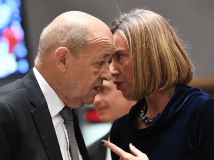 France's Foreign Minister Jean-Yves Le Drian (L) and EU foreign policy chief Federica Mogherini speak together as they arrive for a foreign affair council at the European Council in Brussels, January 22, 2018. / AFP PHOTO / EMMANUEL DUNAND (Photo credit should read EMMANUEL DUNAND/AFP/Getty Images)