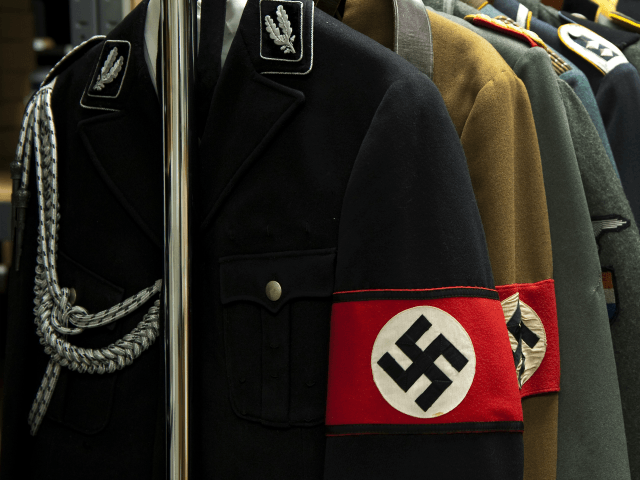 Nazi uniforms on display at Connecticut-based Alexander Autographs on July 19, 2011 in Stamford, Connecticut. The uniforms will be sold separately from some of the diaries of feared Nazi war criminal Josef Mengele, the so-called 'Angel of Death' who carried out gruesome medical experiments on prisoners at Auschwitz, The diaries, …