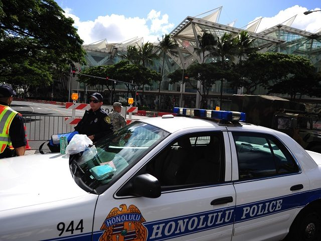 Honolulu police guard road closures around the Convention Center in Honolulu, Hawaii, on November 10 , 2011 during the Asia-Pacific Economic Cooperation (APEC) Summit. The United States hosts this year's APEC forum for the first time since 1993, with leaders from the 21 member economies convening on the island of …