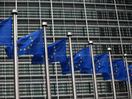 BRUSSELS, BELGIUM - OCTOBER 24: European Union flags are pictured outside the European Commission building on October 24, 2014 in Brussels, Belgium. Alongside criticism from outgoing European Commission president Jose Manuel Barroso on the UK's stance on EU immigration and a plan to quit the European Court of Human Rights, …