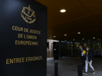 People walk away from the entrance of the European Court of Justice (SCJ) in Luxembourg, on October 5, 2015. The European Court of Justice (ECJ) on October 6, 2015 is to announce a verdict in the case of Schrems v Data Protection Commissioner of Ireland over Schrems's claims that his …