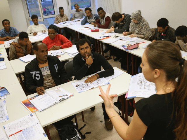 POTSDAM, GERMANY - NOVEMBER 11: Instructor Paulina Kedziora leads an intermediate German language class for migrants and refugees from countries including Eritrea, Afghanistan, Iran, Chechnya and Somalia seeking asylum in Germany on November 11, 2015 in Potsdam, Germany. The classes are paid for by the German Federal Office for Migrants …