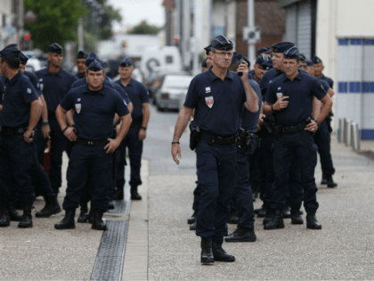 Police officers stand on guard in the streets of Saint-Etienne-du-Rouvray on July 26, 2016, following an attack by two knife-wielding men. The Islamic State group said on July 26 that the two assailants who stormed a church in France and killed an elderly priest were its 'soldiers,'. They stormed the …