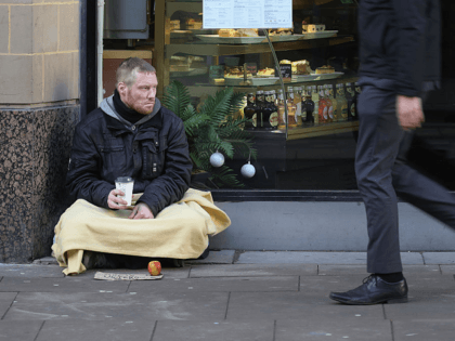 MANCHESTER, ENGLAND - JANUARY 13: Homeless army veteran Phil (no surname given) begs for small change on the streets of Manchester on January 13, 2017 in Manchester, United Kingdom. Many homeless people are spending the night on the streets in freezing temperatures as the Met Office continues to issue weather …