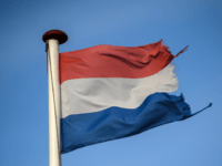 VENLO, NETHERLANDS - FEBRUARY 21: A Dutch flag flies on the country's border with Germany on February 21, 2017 in Venlo, Netherlands. The Dutch will vote in parliamentary elections on March 15 in a contest that, according to some polls, is currently led by far-right candidate Geert Wilders, the leader …