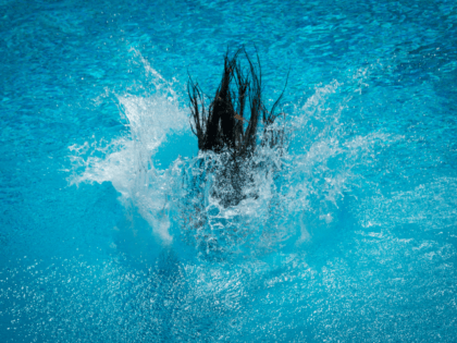 TOPSHOT - A participant of the Splashdiving World Championships jumps into the water of a pool in Sindelfingen, southern Germany, on July 30, 2017. The competition commonly known as 'Arschbomben-WM' (litterally: ass-bomb world championships) requires from participants to jump from a five or ten meters high platform in order to …