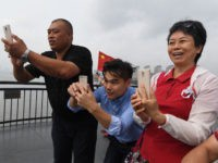 Chinese tourists take photos of North Korea from the Broken Bridge at the Chinese border city of Dandong in China's northeast Liaoning province, opposite the North Korean town of Sinuiju on September 4, 2017. China said on September 4 it had lodged an official protest with its ally North Korea …