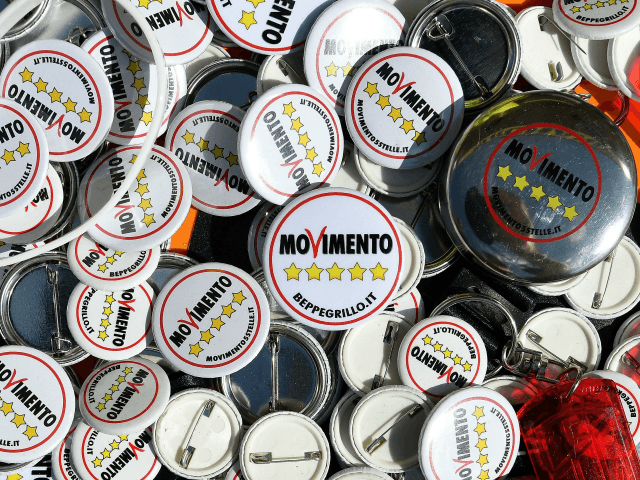 Pins of Italy's populist Five Star Movement (Movimento 5 Stelle - M5S) are seen during the party's congress in Rimini on September 23, 2017. Italy's populist 5-Star Movement announces its candidate for prime minister on September 23 as it braces to attempt a revolutionary shift from protest to ruling party. …