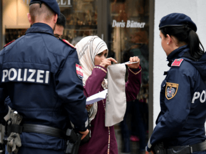 Police officers ask a woman to unveil her face in Zell am See, Austria, on October 1, 2017. Austria's ban on full-face Islamic veils comes into force following similar measures in other European countries. / AFP PHOTO / APA / BARBARA GINDL / Austria OUT (Photo credit should read BARBARA …