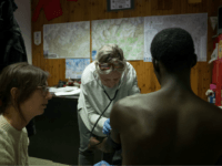 A 26 year old migrant from Guinea is treated for suspected tuberculosis by two doctors of NGO 'Rainbow for Africa' as he arrives in Bardonecchia on January 12, 2018. Migrants are now trying to reach France crossing the Italian Alps by the snow-covered pass Colle della Scala (Col de l'Echelle) …