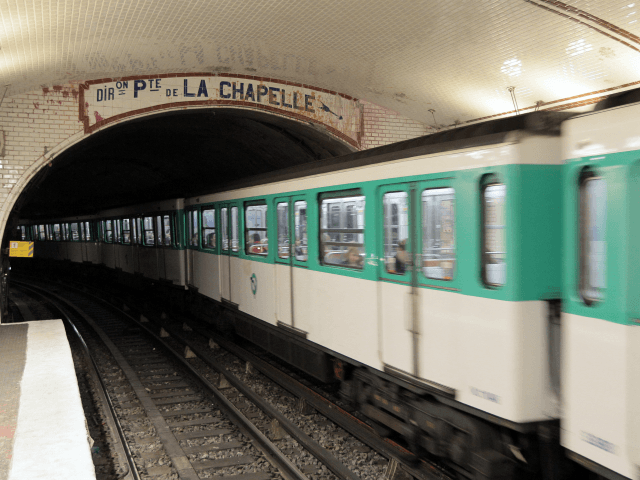 A picture taken on March 25, 2010 in Paris shows a train running at the 'Abbesses' metro station on Line 12 of the Paris Metro in the Montmartre district and the 18th arrondissement. AFP PHOTO JACQUES DEMARTHON (Photo credit should read JACQUES DEMARTHON/AFP/Getty Images)