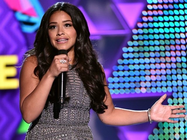 Co-host Gina Rodriguez speaks onstage during the Teen Choice Awards 2015 at the USC Galen Center on August 16, 2015 in Los Angeles, California. (Photo by Kevin Winter/Getty Images)