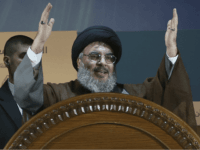 In this Aug. 2, 2013, file photo, Hezbollah leader Sheikh Hassan Nasrallah gestures during a rally to mark Jerusalem day or Al-Quds day, in a southern suburb of Beirut, Lebanon. The leader of Lebanon's Hezbollah on Monday, Nov. 20, 2017, categorically denied accusations that his group is sending weapons to …