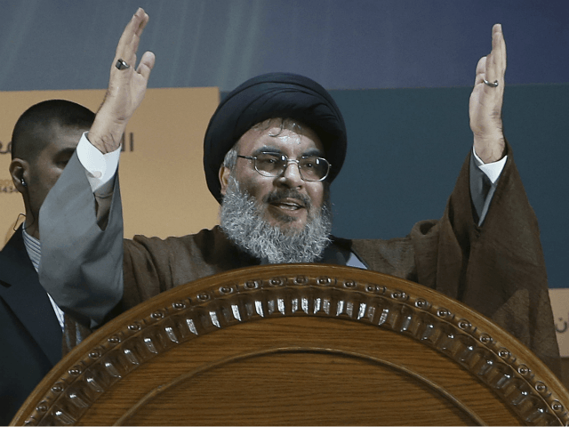In this Aug. 2, 2013, file photo, Hezbollah leader Sheikh Hassan Nasrallah gestures during a rally to mark Jerusalem day or Al-Quds day, in a southern suburb of Beirut, Lebanon. The leader of Lebanon's Hezbollah on Monday, Nov. 20, 2017, categorically denied accusations that his group is sending weapons to Yemen or that it was responsible for a ballistic missile fired by Shiite rebels in Yemen that was intercepted near the Saudi capital, Riyadh. (AP Photo/Hussein Malla, File)