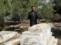 Hatem Abdelkader, an advisor to Palestinian prime minister Salam Fayyad, prays at a Muslim cemetery in Jerusalem on October 30, 2008. Muslim authorities expressed outrage today after the Israeli High Court gave the go-ahead for the construction of a Museum of Tolerance on the site of the Muslim cemetery in Jerusalem. The Mufti of Jerusalem, Sheikh Mohammed Hussein, called the court ruling a 'grave decision' which 'harms the Muslim holy sites.' AFP PHOTO/AHMAD GHARABLI (Photo credit should read AHMAD GHARABLI/AFP/Getty Images)
