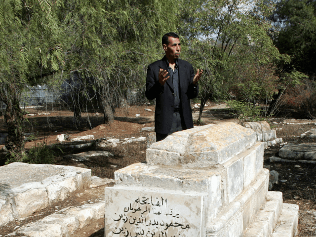 Hatem Abdelkader, an advisor to Palestinian prime minister Salam Fayyad, prays at a Muslim cemetery in Jerusalem on October 30, 2008. Muslim authorities expressed outrage today after the Israeli High Court gave the go-ahead for the construction of a Museum of Tolerance on the site of the Muslim cemetery in …