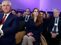 White House Communications Director Hope Hicks, center, and Secretary of State Rex Tillerson, left, listen to President Donald Trump deliver a speech to the World Economic Forum, Friday, Jan. 26, 2018, in Davos. (AP Photo/Evan Vucci)
