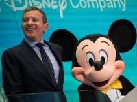 NEW YORK, NY - NOVEMBER 27: (L to R) Chief executive officer and chairman of The Walt Disney Company Bob Iger and Mickey Mouse look on before ringing the opening bell at the New York Stock Exchange (NYSE), November 27, 2017 in New York City. Disney is marking the company's 60th anniversary as a listed company on the NYSE. (Drew Angerer/Getty Images)