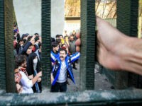 FILE - In this Dec. 30, 2017 file photo, taken by an individual not employed by the Associated Press and obtained by the AP outside Iran, university students attend an anti-government protest inside Tehran University, in Tehran, Iran. As nationwide protests have shaken Iran over the last week, the Islamic Republic increasingly has blamed its foreign foes for fomenting the unrest. So far though, there's no direct evidence offered by Tehran to support that claim. (AP Photo, File)