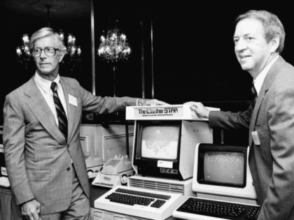 CORRECTS THAT COLEMAN IS AT RIGHT, NOT LEFT - In this July 30, 1981 photo, John Coleman, weather channel founder, right, and Frank Batten, publisher of the Norfolk, Va., Virginian-Pilot and Ledger-Star, and chairman and chief executive of Landmark Communications, Inc., are seen during a news conference in New York. …