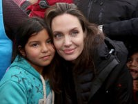 The U.N. refugee agency's special envoy, actress Angelina Jolie poses with a Syrian child during her visit to the Zaatari Syrian Refugee Camp, in Mafraq, Jordan, January 28, 2018. (AP Photo/Raad Adayleh)
