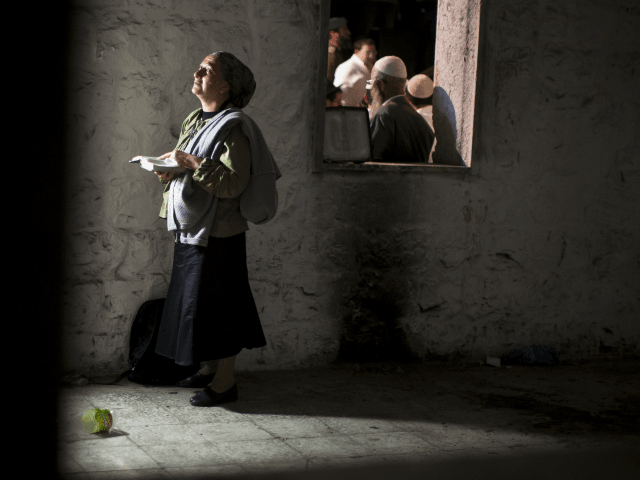 Jewish worshippers pray outside Joseph's Tomb as hundreds of faithful mark the anniversary of the biblical Joseph's death, on July 4, 2011 in Nablus, West Bank. The IDF has ordered a limit to the number of people allowed into Nablus. However, Hilltop Youth have vowed to march on Tomb regardless …
