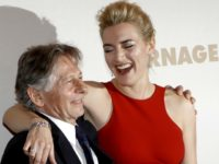 "British actress Kate Winslet, right, poses with film director Roman Polanski before the premiere of his movie ""Carnage"", in Paris, Sunday, Nov. 20, 2011. (AP Photo/Christophe Ena)"