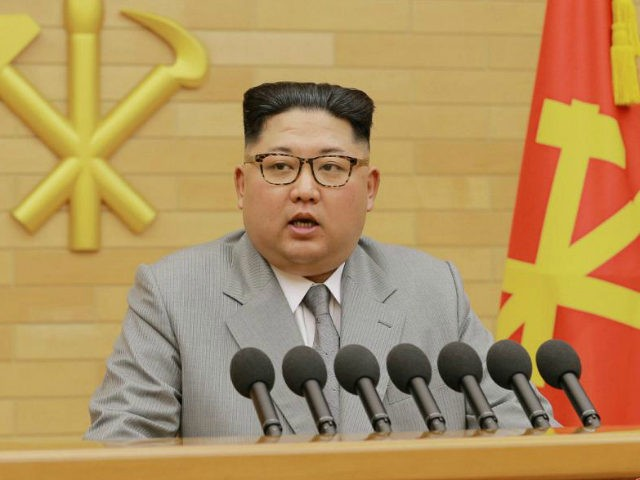 This picture from North Korea's official Korean Central News Agency (KCNA) taken and released on January 1, 2018 shows North Korean leader Kim Jong-Un delivering a New Year's speech at an undisclosed location. Kim Jong-Un vowed North Korea would mass-produce nuclear warheads and missiles in a defiant New Year message …
