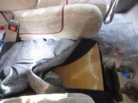 Drug smuggling under car seat.