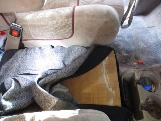 Drug smuggling under car seat.