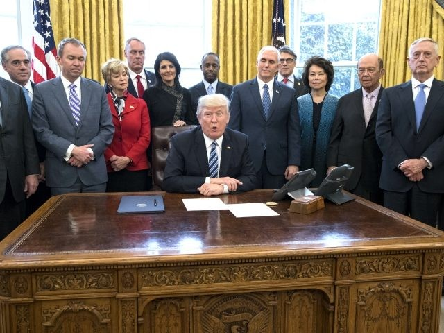 President Donald Trump delivers brief remarks before signing an executive order entitled, 'Comprehensive Plan for Reorganizing the Executive Branch', beside members of his Cabinet in the Oval Office of the White House March 13, 2017 in Washington, DC. Also pictured (L to R); Secretary of State Rex Tillerson, Secretary of …