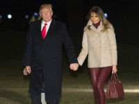 WASHINGTON, DC - JANUARY 1: U.S. President Donald Trump, first lady Melania Trump and their son Barron Trump return to the White House after their stay at Mar-a-Lago in Palm Beach, Florida on January 1, 2018 in Washington, DC. (Photo by Chris Kleponis - Pool/Getty Images)