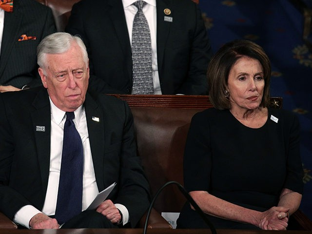 WASHINGTON, DC - JANUARY 30: U.S. Rep Steny Hoyer (D-MD) and U.S. House Minority Leader Nancy Pelosi (D-CA) watch during the State of the Union address in the chamber of the U.S. House of Representatives January 30, 2018 in Washington, DC. This is the first State of the Union address …