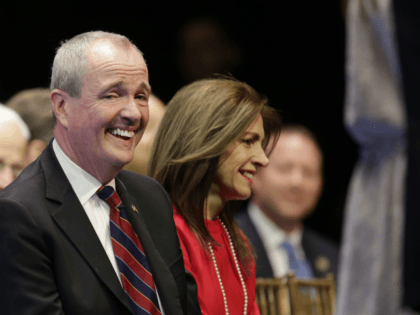 New Jersey Gov.-Elect Phil Murphy laughs during an inauguration ceremony in Trenton, N.J., Tuesday, Jan. 16, 2018. Democrat Phil Murphy became the state's 56th governor, succeeding Republican Chris Christie after he was sworn in at the War Memorial in Trenton Tuesday (AP Photo/Seth Wenig)
