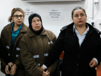 Nour Tamimi and her auntie Nariman Tamimi (2R), who are being detained after a viral video showing them allegedly assaulting two Israeli soldiers, arrive for a hearing in the military court at Ofer military prison in the West Bank village of Betunia on January 1, 2018. Israeli authorities are seeking 12 charges against Ahed Tamimi after the video went viral, her lawyer said. / AFP PHOTO / Ahmad GHARABLI (Photo credit should read AHMAD GHARABLI/AFP/Getty Images)