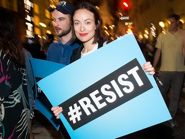 NEW YORK, NY - AUGUST 15: Olivia Wilde joins Michael Moore as he leads his Broadway audience to Trump Tower to protest President Donald Trump on August 15, 2017 in New York City. (Photo by Noam Galai/Getty Images for for DKC/O&M)