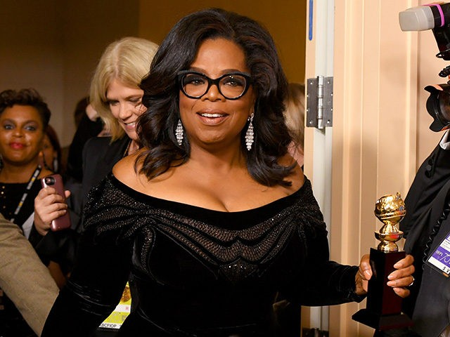 BEVERLY HILLS, CA - JANUARY 07: Oprah Winfrey arrives with the Cecil B. DeMille Award in the press room during The 75th Annual Golden Globe Awards at The Beverly Hilton Hotel on January 7, 2018 in Beverly Hills, California. (Photo by Kevin Winter/Getty Images)