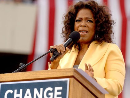 COLUMBIA, SC - DECEMBER 9: Talk show host Oprah Winfrey introduces Democratic presidential hopeful Sen. Barack Obama (D-IL) to a crowd of 29,000 during a campaign event at the William Bryce Football Stadium on December 9, 2007 in Columbia, South Carolina. Obama and Winfrey are scheduled to make one more …