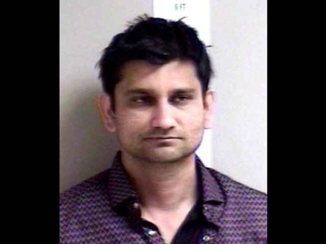 Indian man with wife beside, gropes United States  woman, arrested