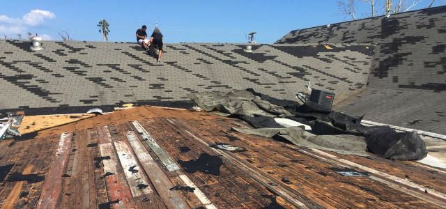 Workers assess damage on roof of First Assembly of God in Rockport, Texas.