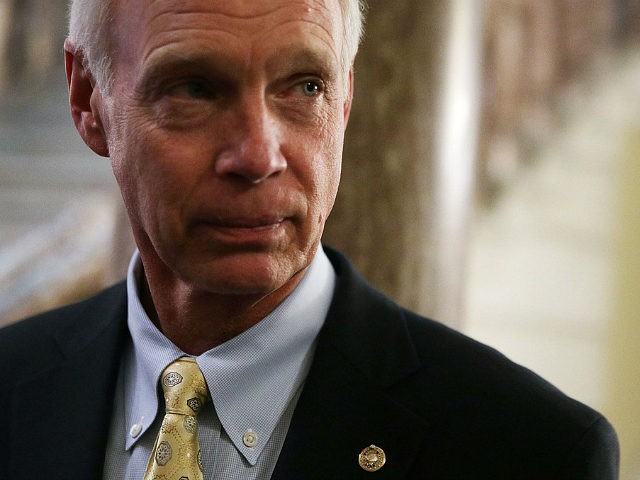 WASHINGTON, DC - DECEMBER 01: U.S. Sen. Ron Johnson (R-WI) listens to a question from a member of the press at the Capitol December 1, 2017 in Washington, DC. Senate GOPs indicate that they have enough votes to pass the tax reform bill. (Photo by Alex Wong/Getty Images)