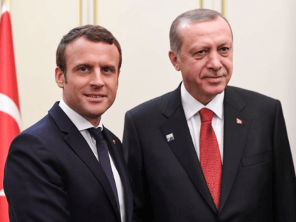 FILE - This is a Thursday May 25, 2017 file photo of French President Emmanuel Macron, left, and Turkish President Recep Tayyip Erdogan as they pose during their meeting which is on the sidelines of the NATO summit, in Brussels. Erdogan is trying to bring Turkey's relations with European nations …
