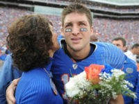 Florida quarterback Tim Tebow embraces his mother, Pam, during a pre-game ceremony for graduating seniors on the Florida football team prior to an NCAA college football game against Florida State in Gainesville, Fla., Saturday, Nov. 28, 2009. (AP Photo/Phil Sandlin, Pool)