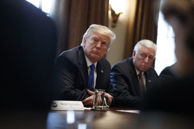 President Donald Trump listens during a meeting with lawmakers on immigration policy in the Cabinet Room of the White House, Tuesday, Jan. 9, 2018, in Washington. (AP Photo/Evan Vucci)