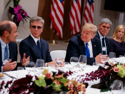 President Donald Trump listens during a dinner with European business leaders at the World Economic Forum, Thursday, Jan. 25, 2018, in Davos. From left, CEO of Anheuser-Busch InBev Carlos Brito, SAP CEO Bill McDermott, Trump, CEO of Seimens Joe Kaeser, and Secretary of Homeland Security Kirstjen Nielsen. (AP Photo/Evan Vucci)