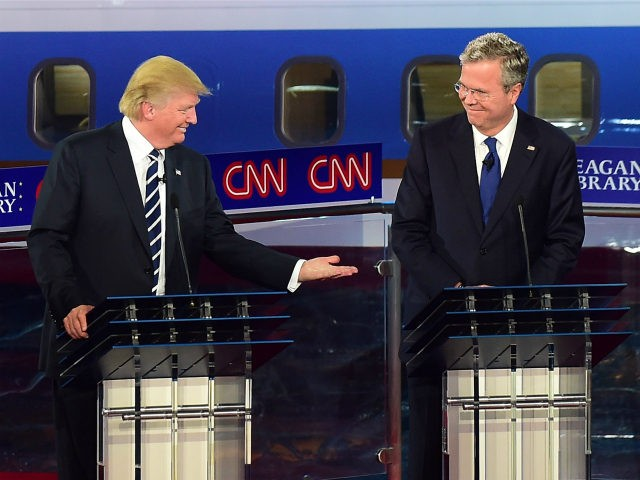 Republican presidential hopefuls, real estate magnate Donald Trump gestures toward former Florida Gov. Jeb Bush (R) during the Republican presidential debate at the Ronald Reagan Presidential Library in Simi Valley, California on September 16, 2015. Republican presidential frontrunner Donald Trump stepped into a campaign hornet's nest as his rivals collectively …