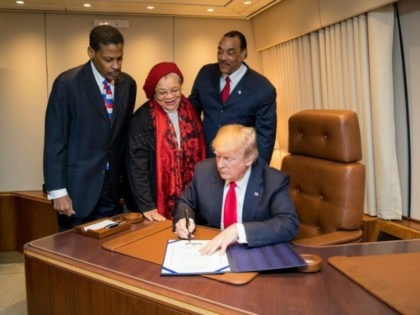 President Donald J. Trump, with Alveda King, center, niece of slain Civil Rights leader Dr. Martin Luther King Jr., and joined by Isaac Newton Farris Jr., left, nephew of Dr. King, and Bruce Levell of the National Diversity Coalition for Trump, right, signs the Martin Luther King Jr. National Historical …