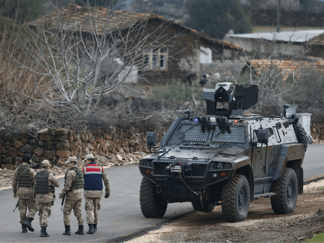 Turkish Army officers block the outskirts of the village of Sugedigi, Turkey, on the border with Syria, Sunday, Jan. 21, 2018. Turkey's ground troops entered the enclave of Afrin, in northern Syria on Sunday and were advancing with Turkish-backed Syrian opposition forces in their bid to oust Syrian Kurdish forces …