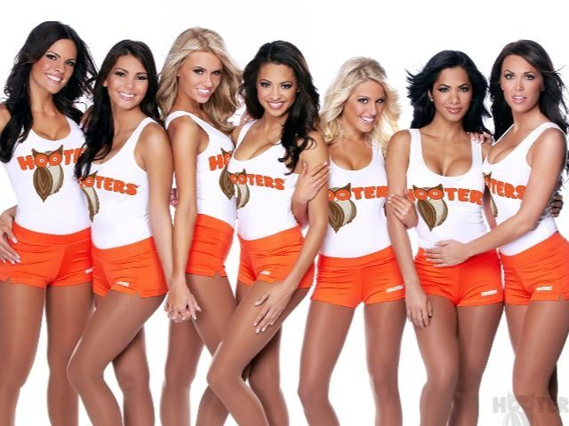 Women wearing the Hooters Restaurant waitress uniform