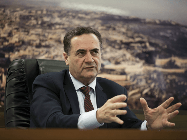 In this Tuesday, March 7, 2017 photo, Israel's transportation and intelligence minister Yisrael Katz speaks during an interview with The Associated Press, in his office in Tel Aviv, Israel. Katz said that he is pushing forward with a proposal to build an artificial island with a seaport off the coast …